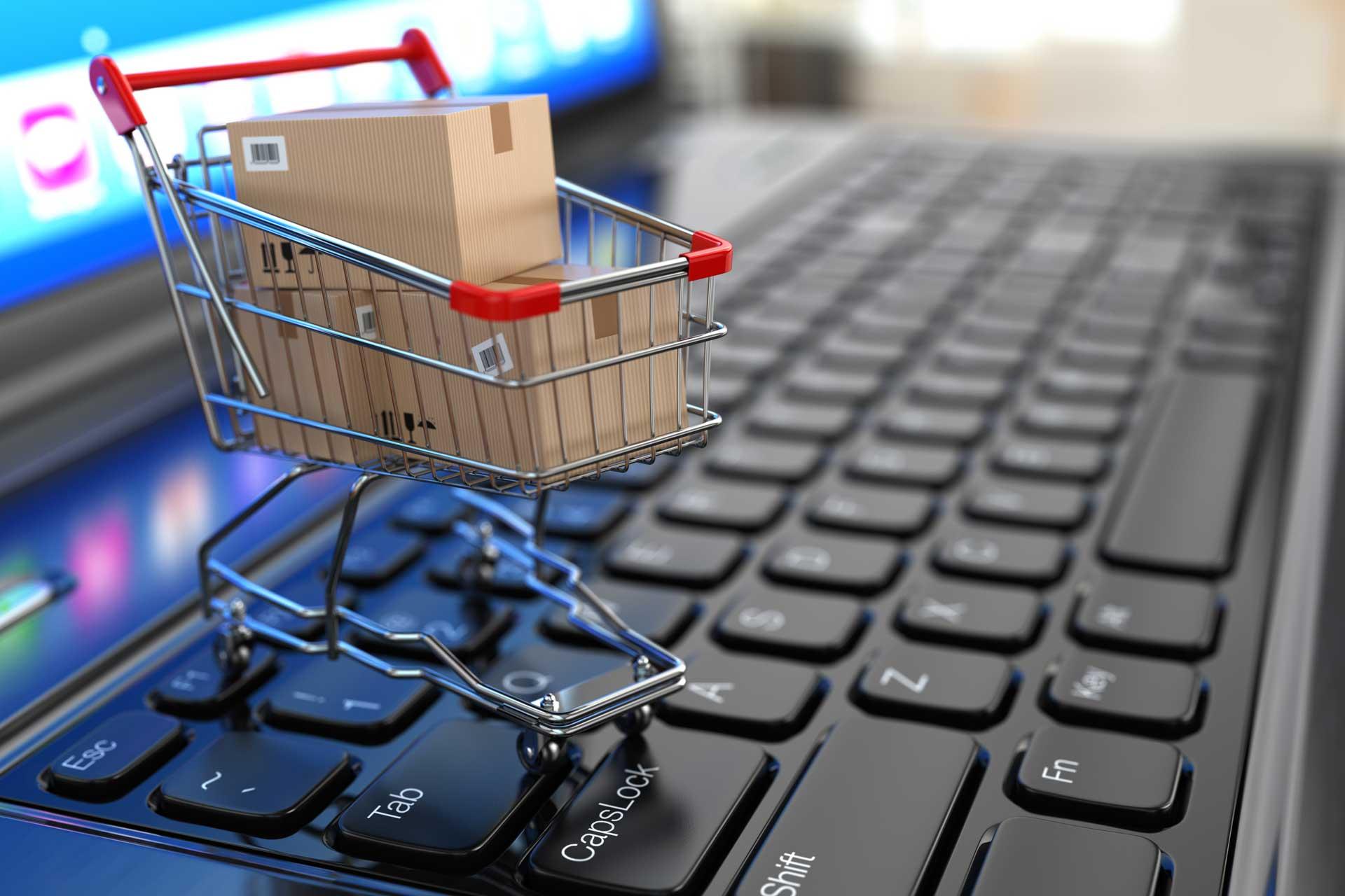 imagen carrito de compra sobre un ordenador